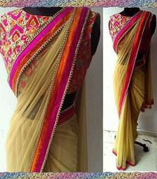 Buy chiku plain net saree With Blouse net-saree online