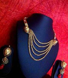 Buy Three layers of golden stones with maroon green stones necklace set j41rg  Necklace online
