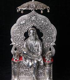 Sai Baba Statue On Peacock Throne in Silver coated metal. Muhenera presents athish collection - 502