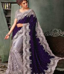 Buy Violet embroidered velvet saree with blouse velvet-saree online
