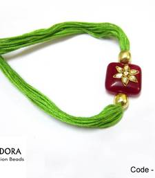 Buy Elegant Jewel Kundan Semi precious Red-Green  Rakhi  express-rakhi online