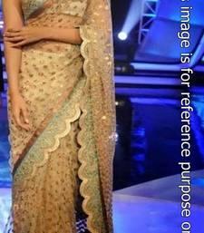 Buy Sonam kapoor golden net saree sonam-kapoor-saree online