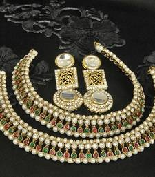 Gold Plated Handcrafted White colour Earrings & Maroon & Green colour Anklets with Pearl shop online