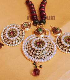 royal big stone and pearls pendent set with pearl mala