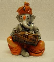 Buy Ganesha Playing Dholak sculpture online