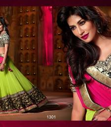 Buy green net lehenga with raw silk blouse lehenga-choli online