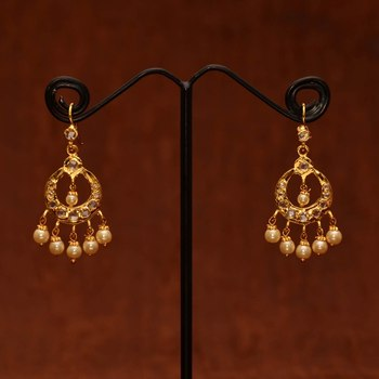 Anvi's chand bali studded with uncut stones and pearl hangings