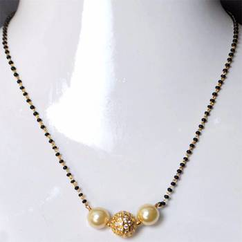 A GOLD PLATED MANGALSUTRA