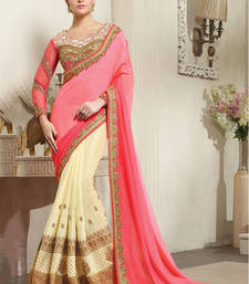 Buy Salmon and cream embroidered silk and crape silk saree with blouse heavy-work-saree online