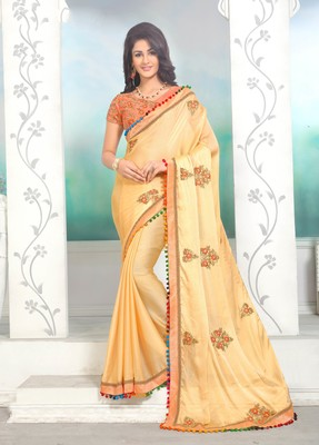 Creamy yellow embroidered georgette saree with blouse