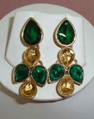 Beige n green ear ring.
