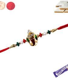 Buy Ganapati rakhi with red and white crystal  with kaju katali rakhi-with-sweet online