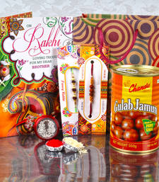 Buy Gift bag of two rakhis and gulab jamun with laxmi ganesh coin and card send-rakhi-to-indium online