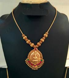 Buy Georgeous gold plated laxmi necklace set curated-jewelry online