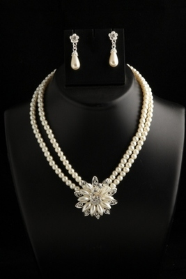smart two layer pearl chain with american diamond flower pendant and earrings