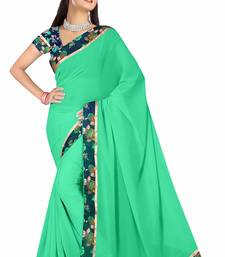 Buy Green printed georgette saree With Blouse Woman online