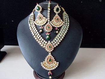 Ravishing Pink & Green Kundan Bridal Set