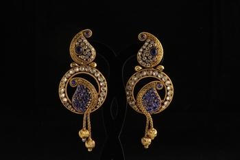 Carie shape studded with blue designer earrings