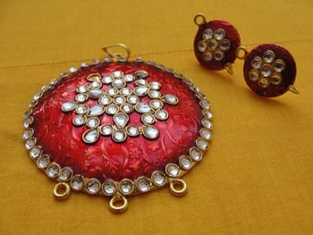 Red Enamel pendent with kundan work on that