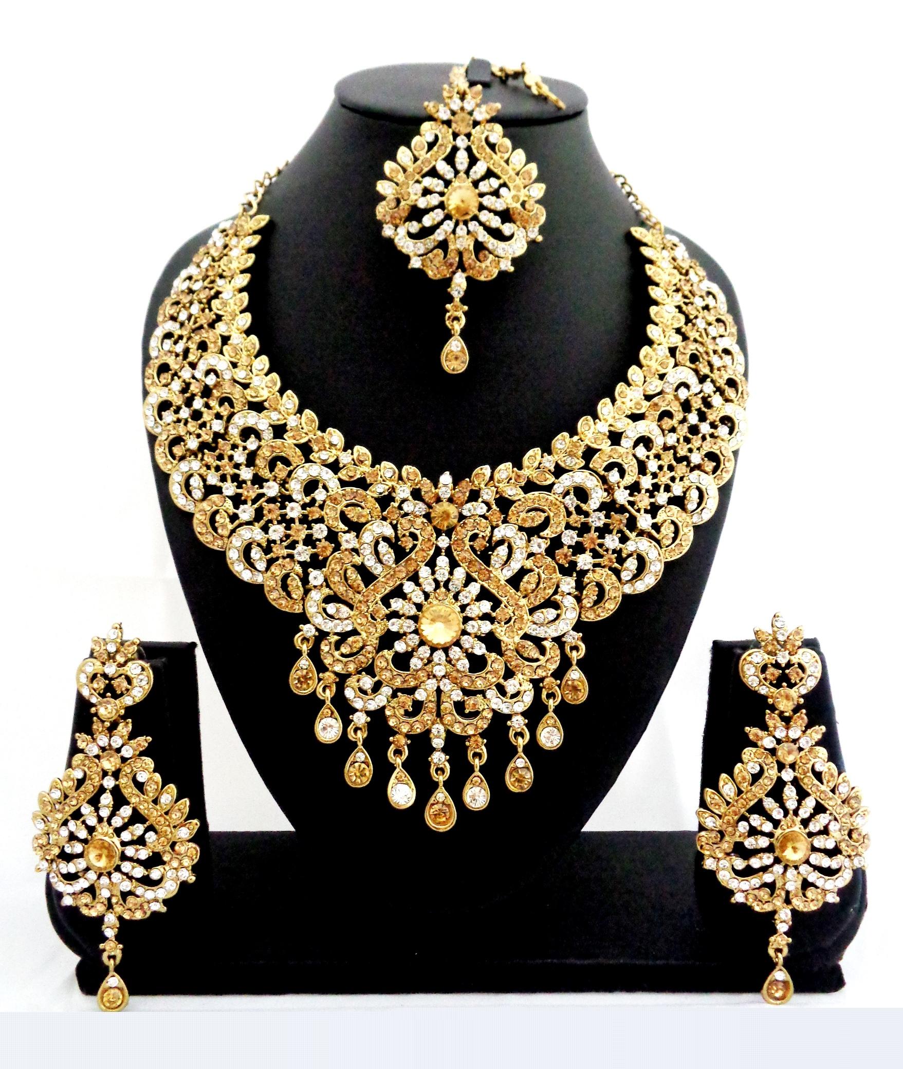 Buy Designer golden stone bridal necklace set with maang tikka Online