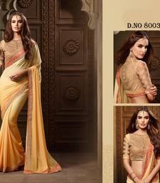 Buy Yellow embroidered georgette saree with blouse hand-woven-saree online