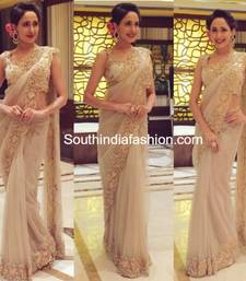 Buy golden embroidered net saree With Blouse net-saree online
