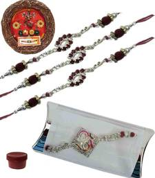 Buy Elegant of four ad and bracelet rakhis with designer thali bracelet-rakhi online