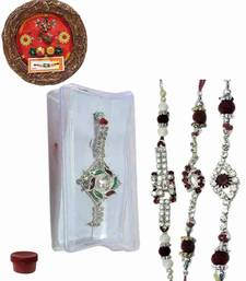 Buy Cherished of four ad and bracelet rakhis with designer thali bracelet-rakhi online