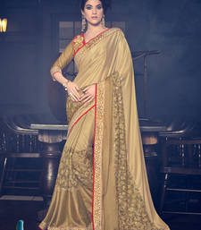 Buy Gold stone work and  cut paste and fancy designs net fancy fabrics saree with blouse heavy-work-saree online