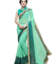 Buy Turquoise embroidered faux georgette saree with blouse Woman online