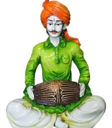 Buy Polyresine Rajasthani Man Playing Dholak Showpiece sculpture online
