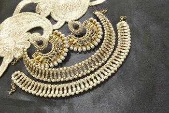 Bollywood Earrings with Black colour stones & White colour Anklets with Kundan