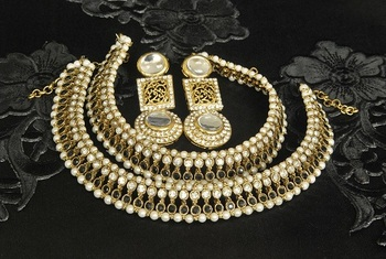 Gold Plated Handcrafted White colour Earrings & Black colour Anklets with Pearl