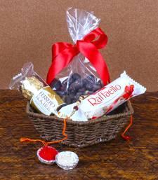 Buy Rakhi Gift of Raffaello with Rocher Chocolates and Choco Cashew rakhi-with-sweet online