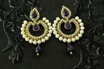 Dangling Purple colour Earrings