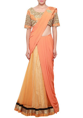 Saree gown enhanced in beige and flame orange embellished in mirror embroidery