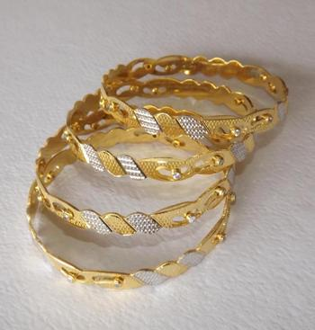 Golden Dancing Bangles  - Set of 4 with American Diamonds