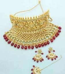 Buy Golden Beige Jadau Kundan Necklace Set with Maang Tika Jewellery for Women necklace-set online