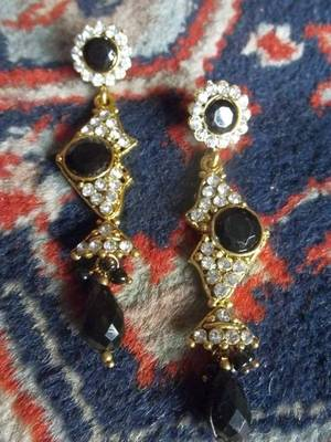 long black gold danglers with stone and diamonds