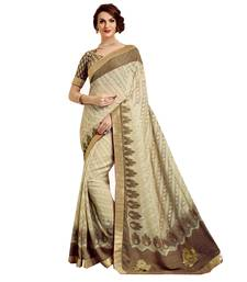 Buy Beige embroidered brasso saree with blouse bollywood-saree online