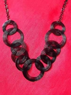 multi circled black metal necklace