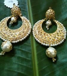 traditional golden heavy earring